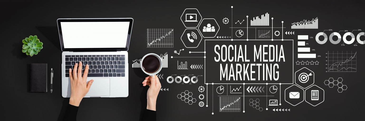 Social media marketing concept with person using laptop computer